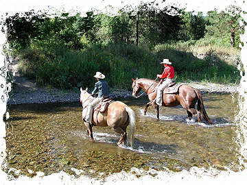 Twin Wranglers cross the Fisher River