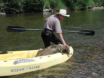 Sage relaxes in sit on top kayak