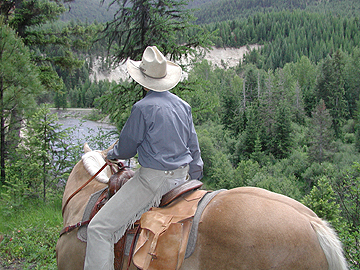 Twin Wrangler, Kim, trail riding above the Fisher River