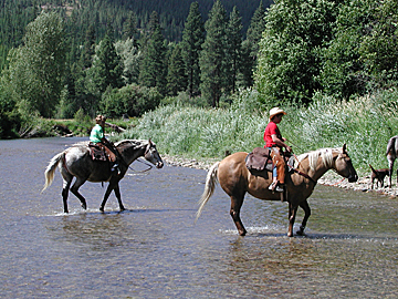 our cousins ride their mounts across the Fishser River